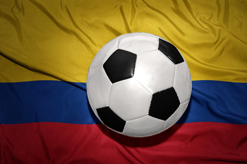 black and white football ball on the national flag of colombia