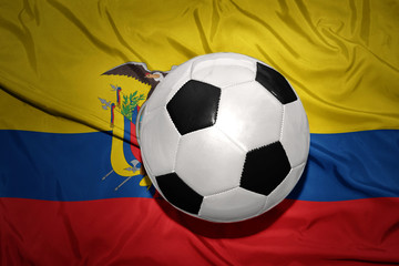 black and white football ball on the national flag of ecuador