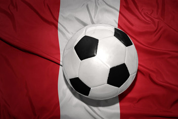 black and white football ball on the national flag of peru