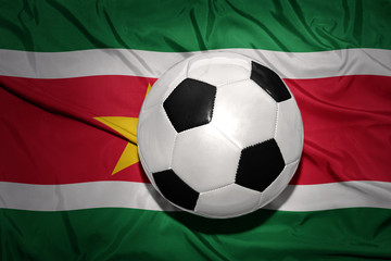 black and white football ball on the national flag of suriname