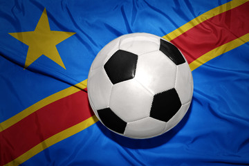 black and white football ball on the national flag of democratic republic of the congo
