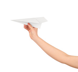 Businesswoman throwing white paper plane. Isolated on white back