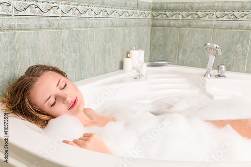 2fd74a34088 Young beautiful woman relaxing in a bath