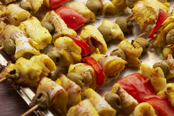 appetizer skewers the fish with vegetables, olives