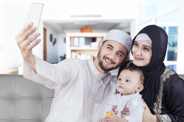 Arabian family taking selfie photo at home