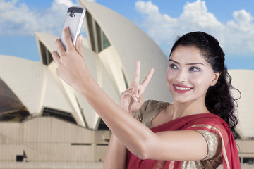 Indian woman taking selfie at Sydney