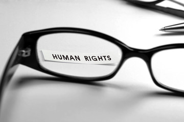 Human rights memo through glasses.