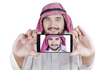 Middle eastern person taking selfie photo