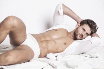 Handsome muscular man in white underwear