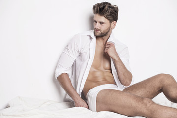 Handsome muscular man in white underwear