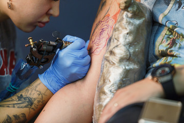 Tattooist makes a tattoo. Closeup