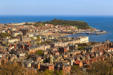 Scarborough town, beach and harbour. Viewed from Oliver's Mount. In Scarborough, England. On 5th May 2016.