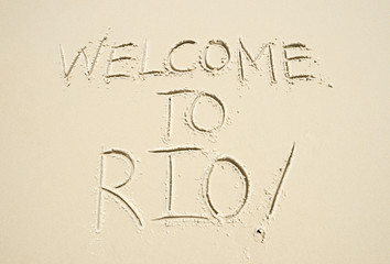 Welcome to Rio (as in, de Janeiro) message handwritten in smooth sand on the beach in Ipanema