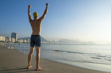 Athlete swimmer standing on Copacabana Beach in Rio de Janeiro, Brazil