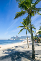 Scenic view of Ipanema Beach from the palm shadows boardwalk at Arpoador in Rio de Janeiro, Brazil