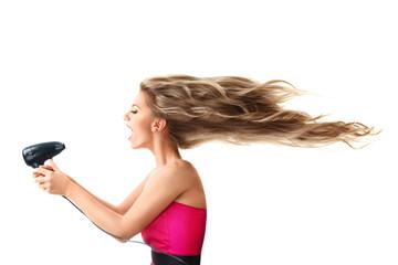 Woman drying long hair with electric fan