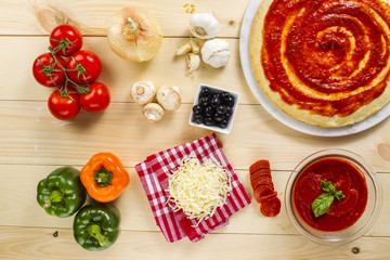 baked pizza and ingredients