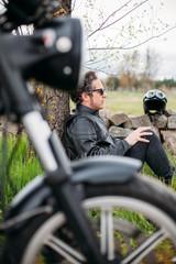 Biker resting on the road