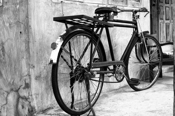 Black and white photo of vintage bicycle - film grain filter effect styles