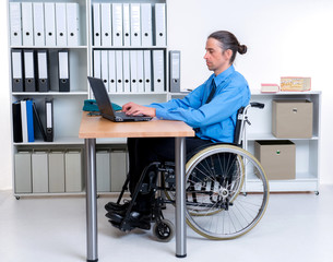 disabled business man in wheelchair working with computer