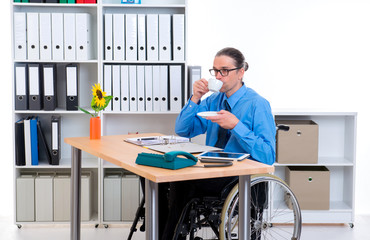 disabled business man in wheelchair drinking coffee