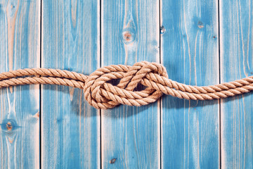 Natural Rope Double Figure Eight Knot on Blue Wood