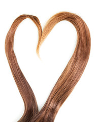 Heart of smooth hair strands isolated on a white