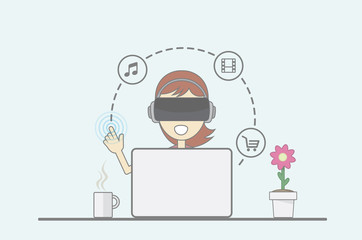 Young girl sitting behind desk in front of laptop uses virtual reality application.