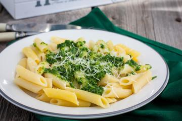Pasta with pesto basil sauce with pine nuts, horizontal