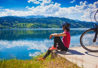 woman with e-bike enjoying view over lake-lake and bike 03