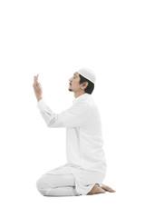 Young muslim man praying