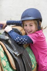 Girl preparing her pony horse