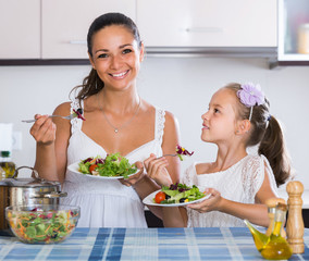 Family of two having healthy lunch with veggies