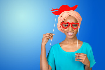 African american woman having fun with photo props