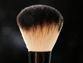 Professional makeup brush on black background