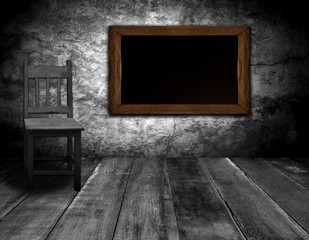 blackboard and chair in interior room