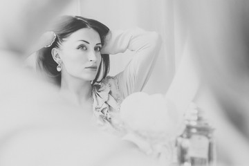The bride make up before the wedding day. Black and white photo