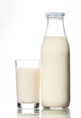 A bottle of rustic milk and glass