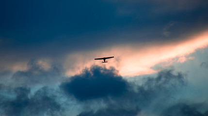 airplane is flying in the sky at evening with amazing colors;