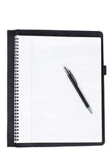 close-up shot of spiral notebook with pen.