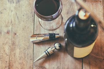 top view image of red wine bottle and corkscrew