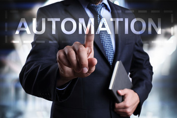 Businessman is pressing on the virtual screen and selecting Automation.