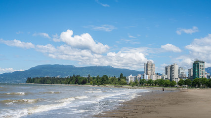 blue clouds sky and city view on the beach