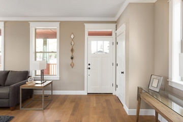 Foyer and entryway in new home with hardwood floors, couch, lamp