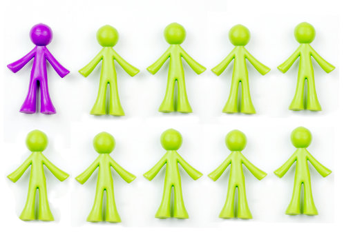 Ten pieces of generic, human shaped plastic pieces in green and purple. One piece is purple, nine pieces are green. Could indicate a demographic of 10% or 90%. Background shadows for depth.