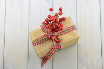 Box with a gift tied with a ribbon.