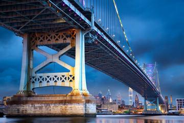 Ben Franklin Bridge above Philadelphia skyline at dusk, US