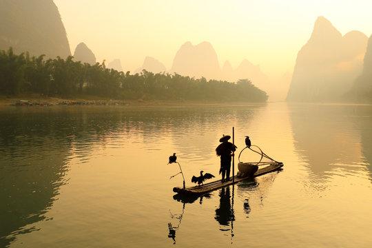 Huangbu (Yellow Cloth) Beach Sunrise on Li River, Xingping, Guilin, China. Xingping is a town in North Guangxi, China. It is 27 kilometers upstream from Yangshuo on the Li River