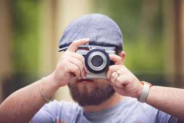 Young stylish photographer with vintage camera