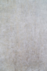 Close-up of an old paper wall texture background.
